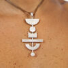 Handmade MIKKO silver pendant with many different shapes in a row
